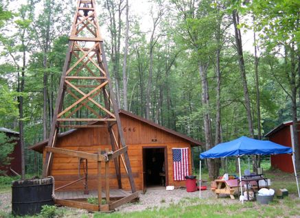 Wooden derrick and museum preserve 1882 oil history of Cherry Grove, PA.
