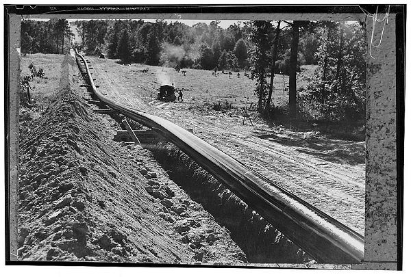 oil pipelines trench with pipeline in woods